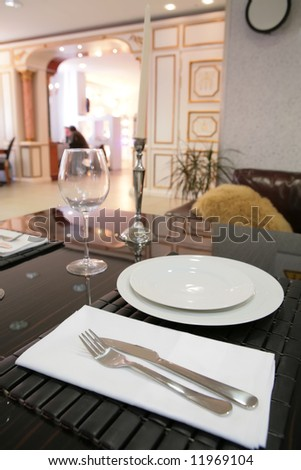 dinning-room in classical style with white plate and candle