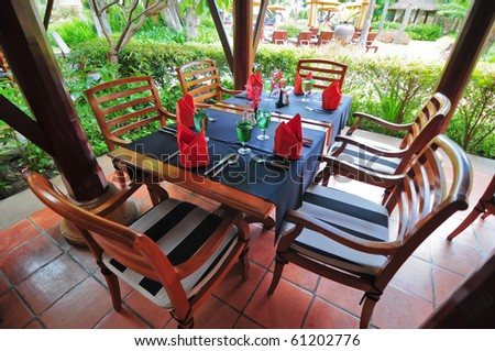 Dinning tables at the outdoor restaurant - stock photo
