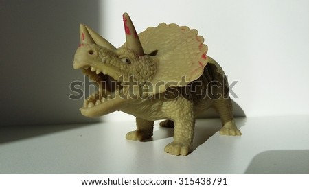 Dinosaur rubber toy photo with shades - stock photo