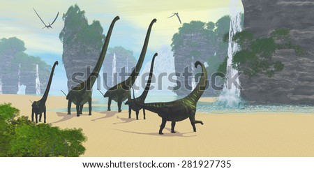 Dinosaur Seashore - A Mamenchisaurus dinosaur herd comes down to a lake for a drink of water with two Pteranodon flying reptiles hunting for fish. - stock photo