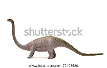 Dinosaur toy over a white background.