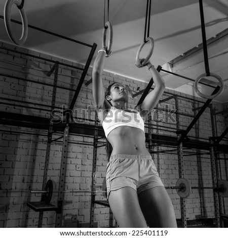 dip ring girl woman muscle ups rings workout at gym - stock photo