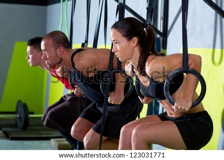 dip ring group workout at gym dipping in a row exercise - stock photo
