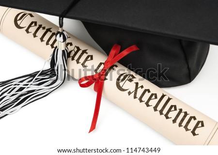 Diploma and black graduation cap - stock photo