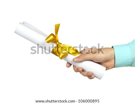 Diploma with a gold ribbon in  hand isolated on white - stock photo