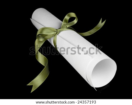 Diploma with a green silk ribbon, isolated on black background. - stock photo
