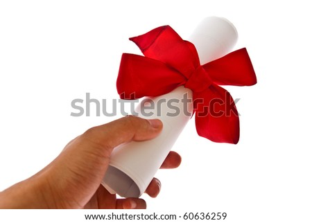 Diploma with a red ribbon in man's hand isolated on a white background - stock photo