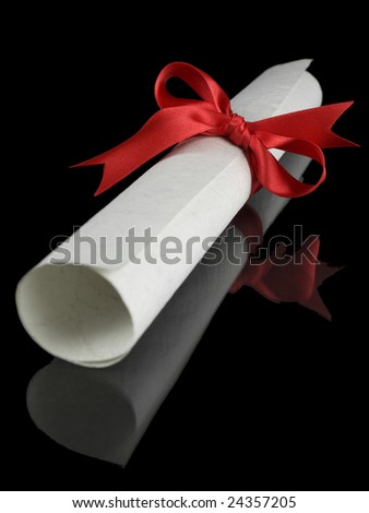 Diploma with a red silk ribbon, isolated on black background. - stock photo