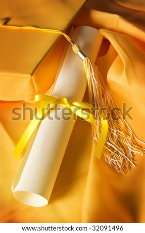 Diploma with Graduation Hat - stock photo