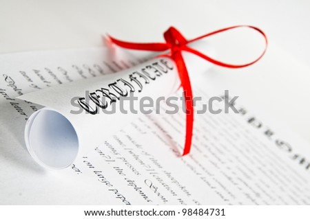Diploma with red ribbon