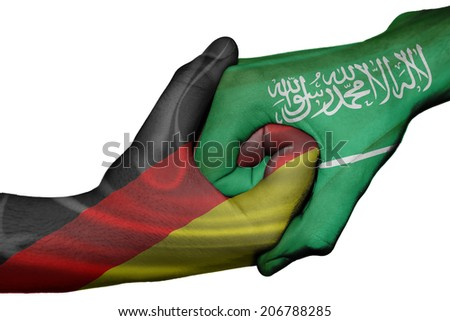 Diplomatic handshake between countries: flags of Germany and Saudi Arabia overprinted the two hands - stock photo