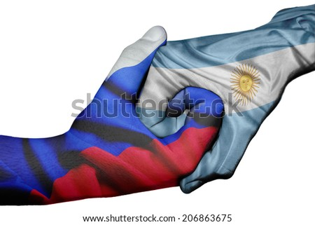 Diplomatic handshake between countries: flags of Russia and Argentina overprinted the two hands - stock photo