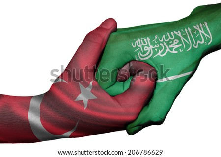 Diplomatic handshake between countries: flags of Turkey and Saudi Arabia overprinted the two hands - stock photo
