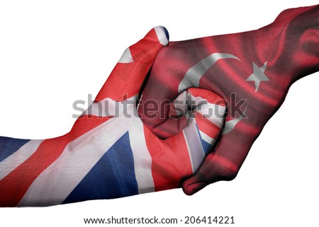 Diplomatic handshake between countries: flags of United Kingdom and Turkey overprinted the two hands