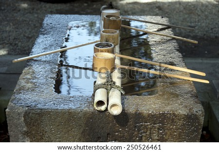 Dipper and water  in washing area at Japanese Shrine