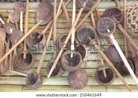 Dipper made from coconut shell, traditional container for drinking water of Thai people - stock photo