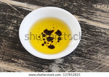 Dipping condiment of olive oil and balsamic vinegar ready to serve.