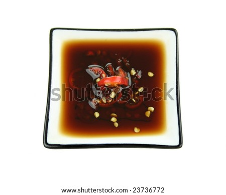 Dipping sauce of soy sauce with fresh diced chillies. - stock photo
