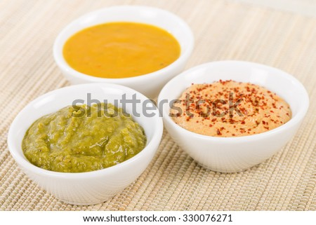 Dipping Sauces - Amarillo Chilli Sauce, Chimichurri and Roasted Pepper. - stock photo