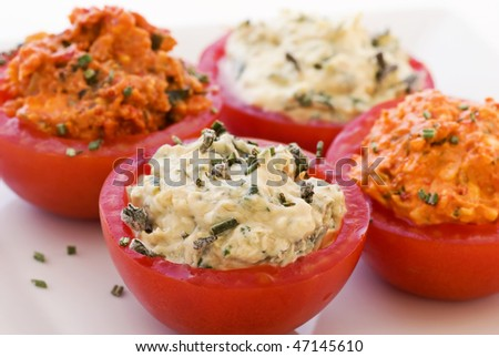 Dips in half Tomatoes - stock photo