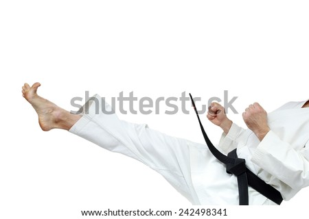 Direct blow leg is doing sportsman with black belt - stock photo