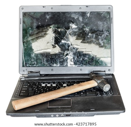 direct view of old broken laptop with hammer on keyboard isolated on white background - stock photo