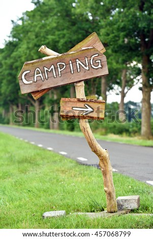 Direction Arrow, Handmade wooden sign to Camping site - stock photo