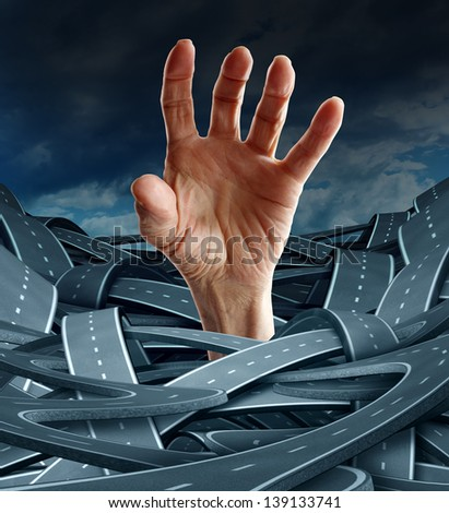 Direction despair as a business concept to free yourself from confusion and  management problems with an opened human hand reaching for freedom from a group of confused rads and highways. - stock photo