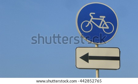 direction for bicycles. road sign indicating access only to bicycles. empty copy space for inscription. Blue circle symbol on sky background  - stock photo