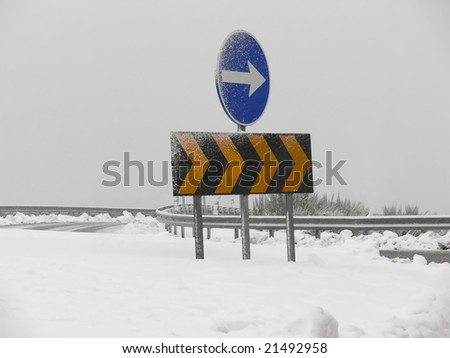 Direction Highway sign in the snow - stock photo