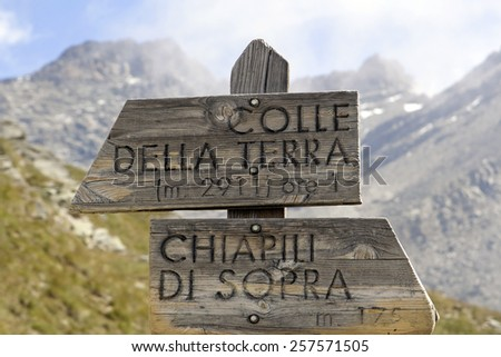 Direction indicator in the mountains. Gran Paradiso National Park in the Alps, Italy - stock photo