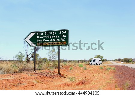 Direction road signs to Alice Springs and Stuart Highway via the Ernest Giles road, Australia