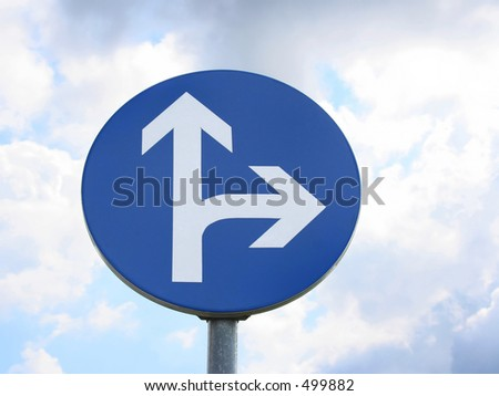 direction sign against blue sky