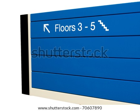 Direction sign in an office building - stock photo