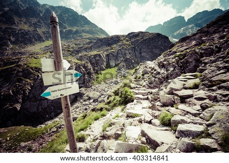 Direction sign on mountain trail, High Tatras, Poland