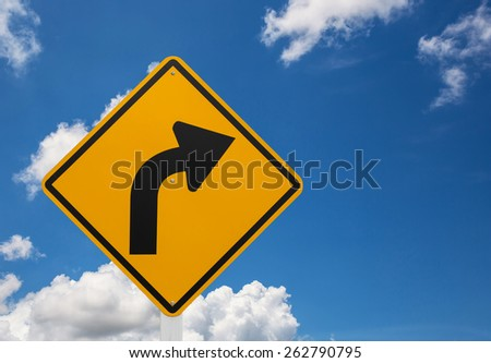 Direction sign- right turn warning on blue sky - stock photo