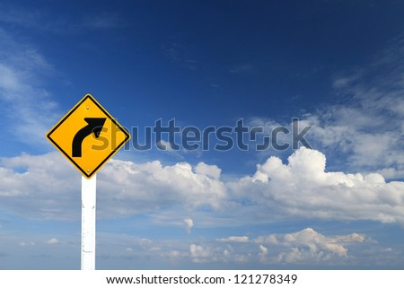 Direction sign- right turn warning on blue sky background with blank for text - stock photo