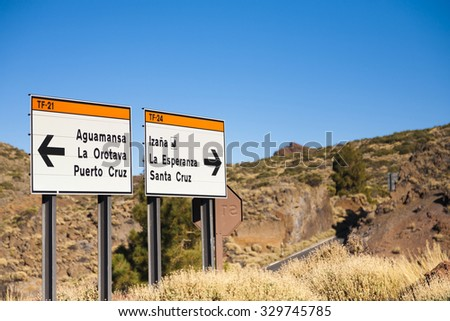 Direction Sign road in El Teide National Park with clear blue sky, Canary Islands