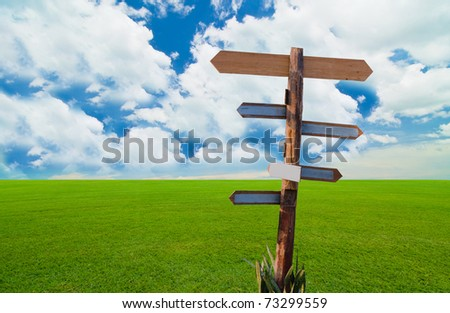 direction sign under the blue sky - stock photo