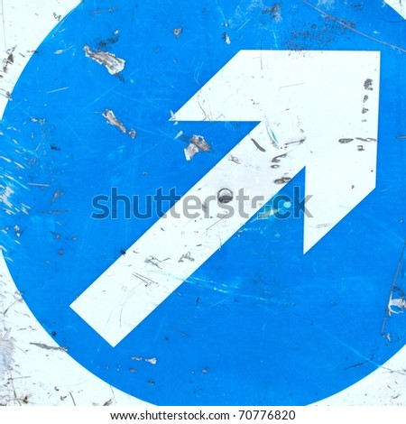 Direction sign with white arrow over blue background - stock photo