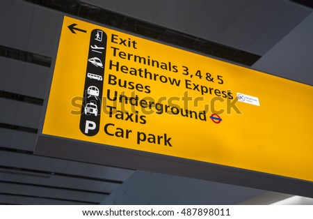 Direction signs at London Heathrow Airport - LONDON / ENGLAND - SEPTEMBER 14, 2016