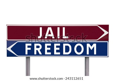 Direction Signs with choice between Jail or Freedom isolated on white background - stock photo