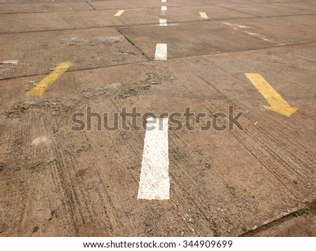 Directional arrow signs on the cement road - stock photo