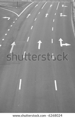 Directional arrows on a multi-lane highway. Concept of choices and pathways for the future.