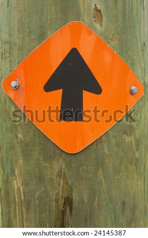 Directional one-way sign on a wooden pole. - stock photo