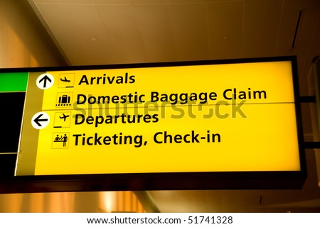 Directional sign inside Terminal 4, Kennedy airport - stock photo