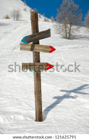 Directional sign post on the snow - stock photo
