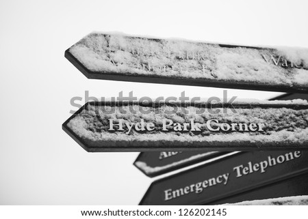 Directions sign in Hyde Park after three days of blizzards. - stock photo
