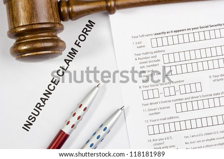 Directly above photograph of an insurance claim form. - stock photo