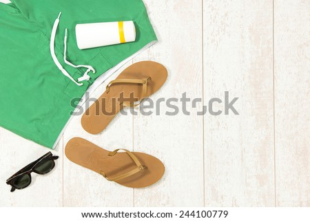 Directly above shot of beach supplies on floorboard - stock photo